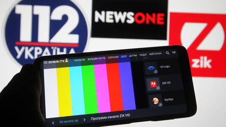 In this photo illustration a rainbow TV test pattern without broadcast on Zik TV channel is seen displayed on a mobile phone screen in front of 112 Ukraine, NewsOne and ZIK logos of Ukrainian TV channels. © Pavlo Gonchar/SOPA Images/LightRocket via Getty Images