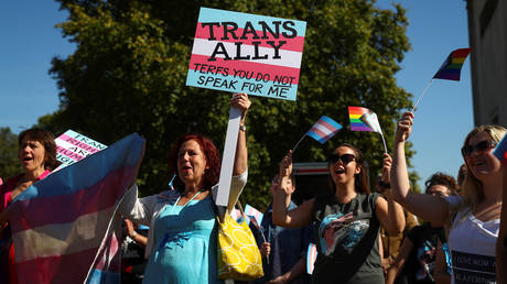 FILE PHOTO: Protesters hold up placards during the first ever Trans Pride March in London, Britain, September 14, 2019 © Reuters / Simon Dawson