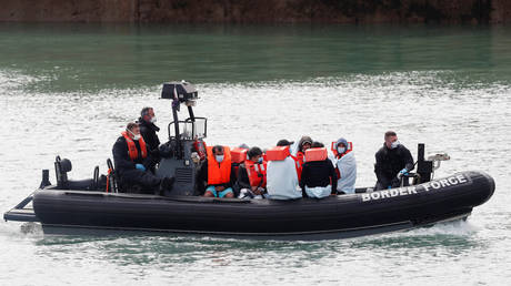 FILE PHOTO. Border Patrol agents bring migrants into Dover harbour on a boat, after they tried to cross the channel, in Dover, Britain. © REUTERS/Matthew Childs