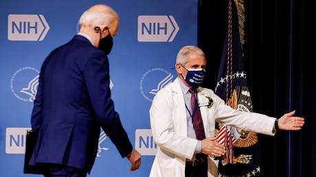 Dr. Anthony Fauci is shown directing Joe Biden during the president's visit to the National Institutes of Health in February.