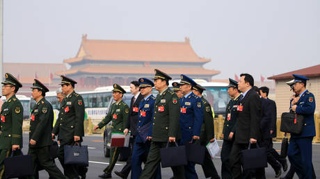 Military delegates arrive for the opening session of the Chinese People's Political Consultative Conference (CPPCC) at the Great Hall of the People in Beijing, China March 3, 2019.