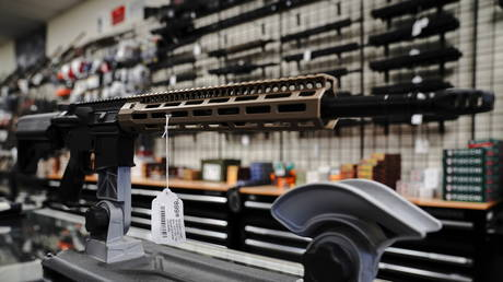 """An """"FU"""" custom upper receiver for an AR-15 style rifle is displayed for sale at Firearms Unknown, a gun store in Oceanside, California, U.S., April 12, 2021. © REUTERS/Bing Guan"""