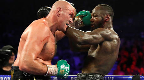 Deontay Wilder (right) has again complained that Tyson Fury's gloves were tampered with © Steve Marcus / Reuters