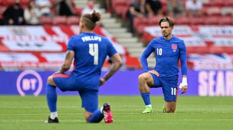 England players 'take a knee' ahead of football match with Romania