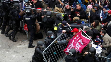 FILE PHOTO: Pro-Trump protesters clash with police during a rally to contest the certification of the 2020 presidential election results, at the US Capitol Building in Washington, DC, January 6, 2021.