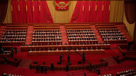 A general view shows the closing session of the National People's Congress (NPC) at the Great Hall of the People in Beijing on March 11, 2021. © NICOLAS ASFOURI / AFP