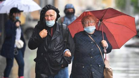 Masked people in a Moscow street