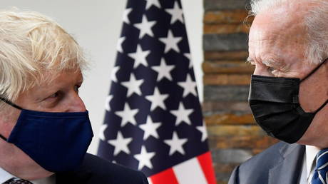 U.S. President Joe Biden speaks with Britain's Prime Minister Boris Johnson, as they look at historical documents and artefacts relating to the Atlantic Charter during their meeting, at Carbis Bay Hotel, Carbis Bay, Cornwall, Britain June 10, 2021