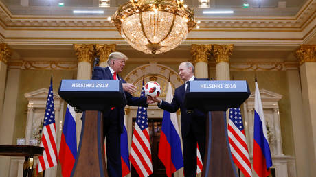 Russian President Vladimir Putin gifts a football to his US counterpart Donald Trump after a meeting in Helsinki, Finland, July 16, 2018.