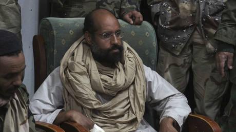 Saif al-Islam is seen after his capture, in the custody of revolutionary fighters in Obari, Libya November 19, 2011
