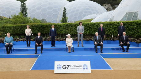 World leaders pose for a group photo during a drinks reception on the sidelines of the G7 summit, at the Eden Project in Cornwall, Britain June 11, 2021.