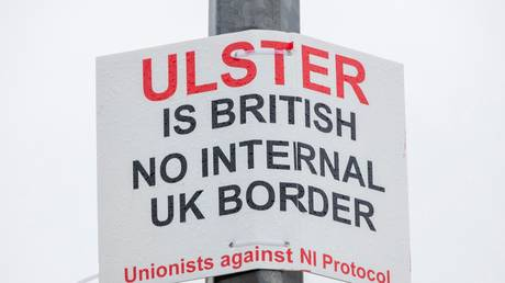 A Unionist poster opposing a possible UK internal border in the Port of Larne, Northern Ireland, UK, February 2021. © Paul Faith/AFP
