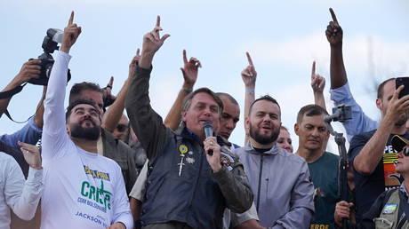Brazil's President Jair Bolsonaro participates in a motorcade rally in Sao Paulo, Brazil, on June 12, 2021.