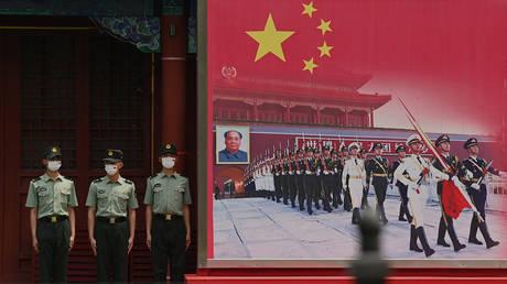 Chinese soldiers in Beijing, June 12, 2021. © Noel Celis/AFP