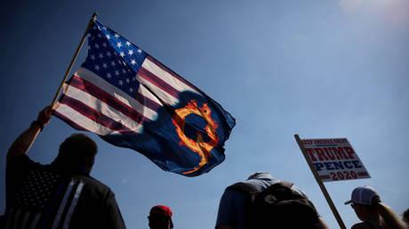 QAnon symbols at a pro-Trump rally in Portland, Oregon, September 7, 2020.