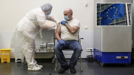 A man receives an injection with Sputnik V vaccine against the coronavirus disease (COVID-19) at a vaccination centre opened at the Yandex Go centre for drivers and couriers in Moscow, Russia January 27, 2021. © REUTERS/Maxim Shemetov; (inset) © Carl Court/Getty Images
