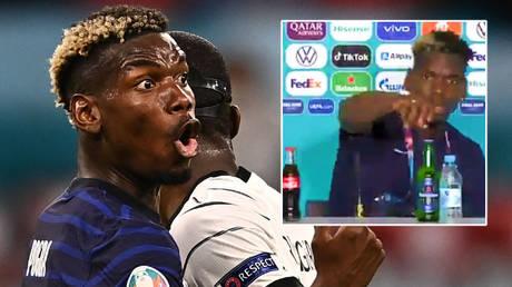 Paul Pogba moved a bottle of Heineken after helping France beat Germany © Lukas Barth-Tuttas / Reuters | © Twitter / ElijahKyama