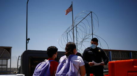 Asylum-seekers crom Central America previously expelled from the US seek to cross the US-Mexican border at Ciudad Juarez, June 15, 2021.