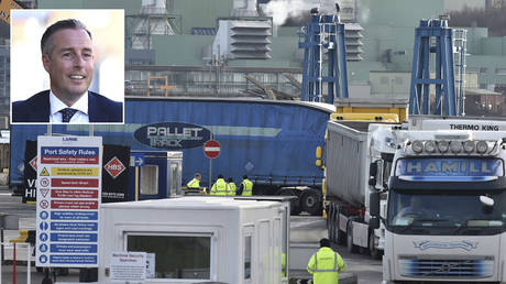 DAERA port inspection staff are seen watching freight exiting the Cairnryan to Larne ferry on February 10, 2021 in Larne, Northern Ireland. © Charles McQuillan/Getty Images; (inset) Paul Givan © REUTERS/Clodagh Kilcoyne