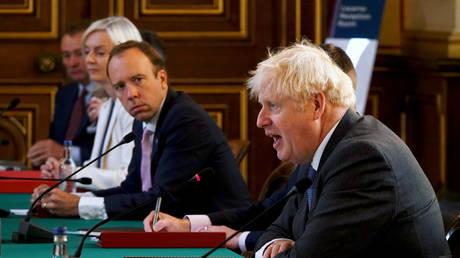 British Health Secretary Matt Hancock looks on as Prime Minister Boris Johnson speaks at a cabinet meeting at the Foreign Office in London, Britain September 15, 2020.
