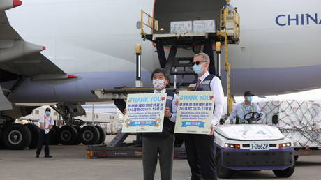 Taiwan's Health Minister Chen Shih-chung and top US diplomat in Taiwan, Brent Christensen, hold Moderna vaccines shipped from the United States, at Taoyuan International airport in Taoyuan, Taiwan, June 20, 2021. ©Taiwan Centers for Disease Control/Handout via REUTERS