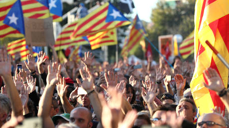 FILE PHOTO. Catalan pro-independence demonstrators call for the release of jailed separatist leaders in Barcelona, Spain.