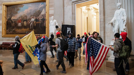 FILE PHOTO. Supporters of US President Donald Trump walk around in the Rotunda after breaching the US Capitol in Washington, DC. © AFP / SAUL LOEB.