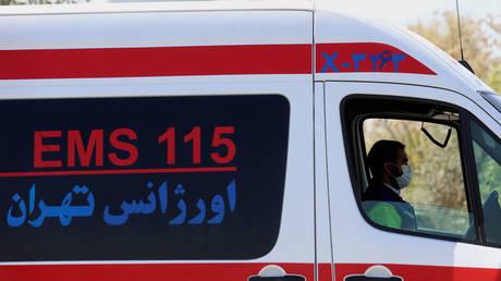 FILE PHOTO: An emergency member sits inside an ambulance in Tehran, Iran March 30, 2021. ©  Majid Asgaripour/WANA via Reuters