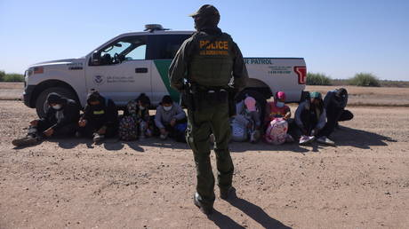 FILE PHOTO: A group of asylum seekers from Mexico, Cuba and Haiti are detained by US Border Patrol in San Luis, Arizona, April 19, 2021.