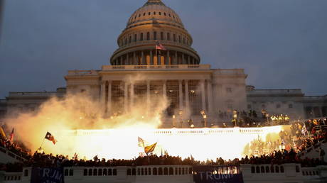 FILE PHOTO: An explosion caused by a police munition is seen while supporters of then-President Donald Trump gather in front of the US Capitol Building in Washington, DC, January 6, 2021.