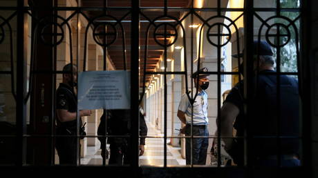 Police officers are seen at the entrance of Petraki Monastery in Athens, Greece, June 23, 2021.© REUTERS/Costas Baltas