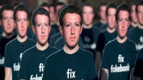 One hundred cardboard cutouts of Facebook founder and CEO Mark Zuckerberg stand outside the US Capitol in Washington, DC, April 10, 2018. © SAUL LOEB / AFP