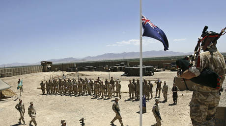 Australian and British troops stand at attention during an ANZAC day ceremony at Camp Armadillo in Helmand Province April 25, 2008. © REUTERS/Omar Sobhani
