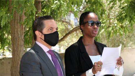 Janice McAfee, wife of John McAfee, with lawyer Javier Villalba, speaks to media in Sant Esteve Sesrovires, Spain
