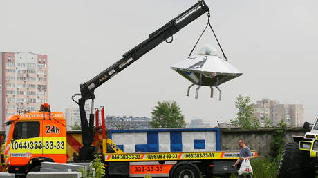 An UFO flying saucer advertises a towing company in Kiev, Ukraine May 28, 2021.