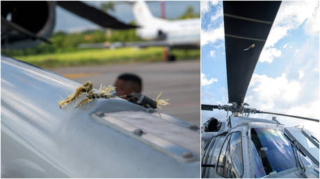 The marks of projectile impacts are seen on a helicopter that carried Colombian President Ivan Duque, after it came under attack during an overflight near Cucuta, Colombia, June 25, 2021.