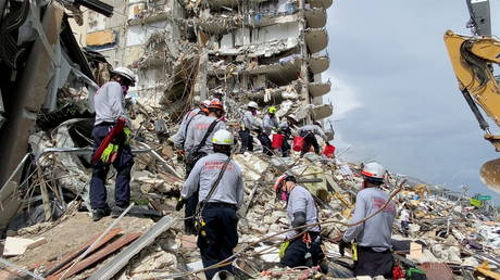 Rescue crews respond at the site after a partial building collapse in Surfside near Miami Beach, Florida, US, June 25, 2021.