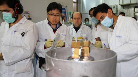 FILE PHOTO: IAEA inspectors working at an Iranian nuclear facility. © AFP / IRNA / Kazem Ghane