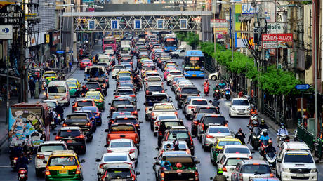 Cars sit in a traffic jam on a street in Bangkok on February 5, 2021.