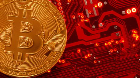 Representation of cryptocurrency Bitcoin is placed on PC motherboard in this illustration taken, June 29, 2021.