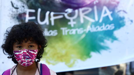 Pete, 9, a transgender minor, takes part in a protest to mark LGBT Pride Day in Madrid, Spain, June 28, 2021.