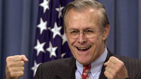 """FILE PHOTO: US Secretary of Defense Donald Rumsfeld tells reporters """"freedom's untidy,"""" describing the anarchy in post-invasion Iraq, at the Pentagon briefing, April 11, 2003."""
