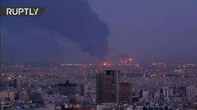 Huge plume of black smoke towers over Tehran as major blaze breaks out at Iranian refinery (VIDEOS)