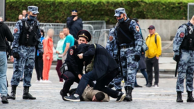 Russian activist arrested on Moscow's Red Square after firing pistol in air multiple times & faking suicide gunshot to his head