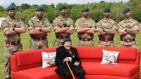 Wrong D-Day? British Army mocked after accidentally recreating porn meme with WWII veteran couch photo