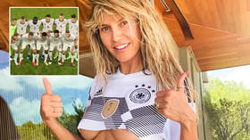 'Good luck today, Germany': Supermodel Heidi Klum leaves very little to the imagination as she cheers nation in tiny football top
