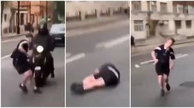 WATCH: Scotland fan knocked down by motorbike while friend LAUGHS as Tartan Army invade London for Euro 2020 clash