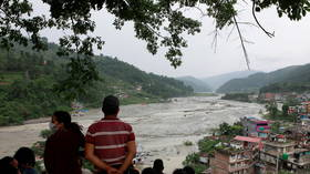 Foreign workers among 11 killed & 25 missing after landslide & floods hit Nepal, officials say (VIDEO)