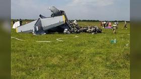 At least 9 killed after twin-engine plane crash-lands in southwest Siberia (VIDEO)