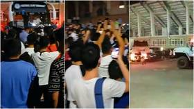 Terrifying Ord-eal: Riotous scenes as protesting football fans block team bus from leaving stadium after latest defeat (VIDEO)